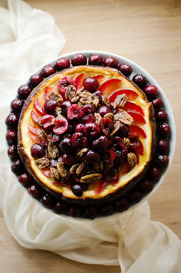 Stone Fruit Triple-Cheesecake: savory brie and goat cheese cheesecake on a rosemary rice cracker crust, topped with glazed fruit and candied pecans