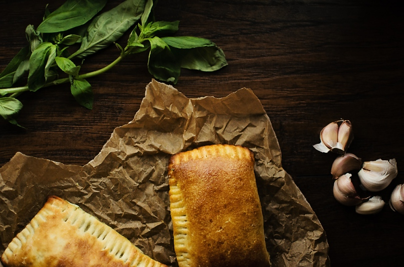Pistachio Pesto Pocket: mozzarella cheese, pistachio pesto, potatoes, and peas wrapped in pizza dough - our most alliterative recipe yet.